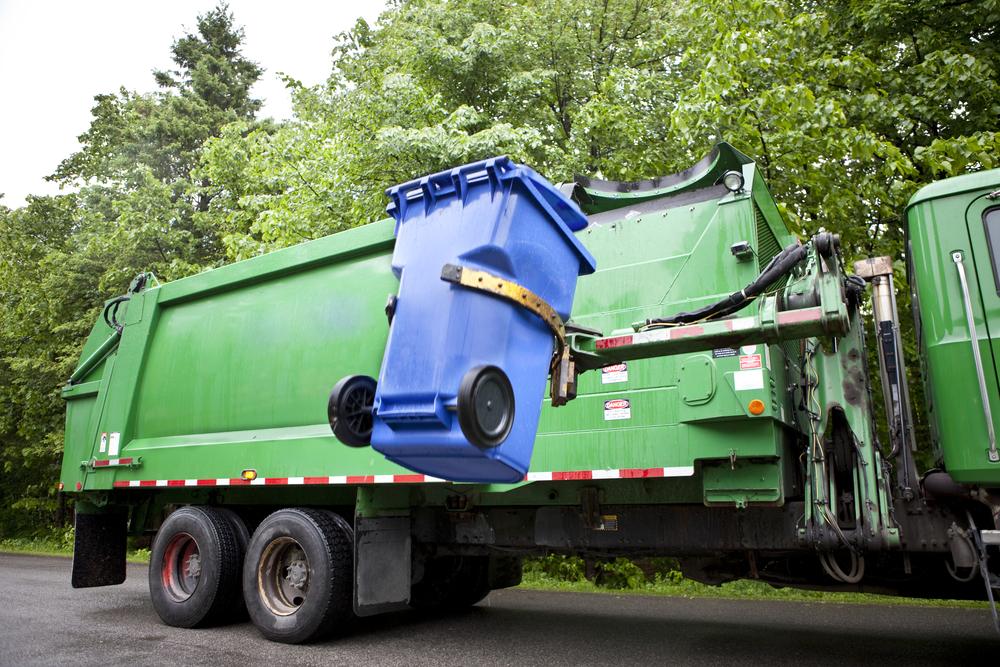 garbage truck picks up trash